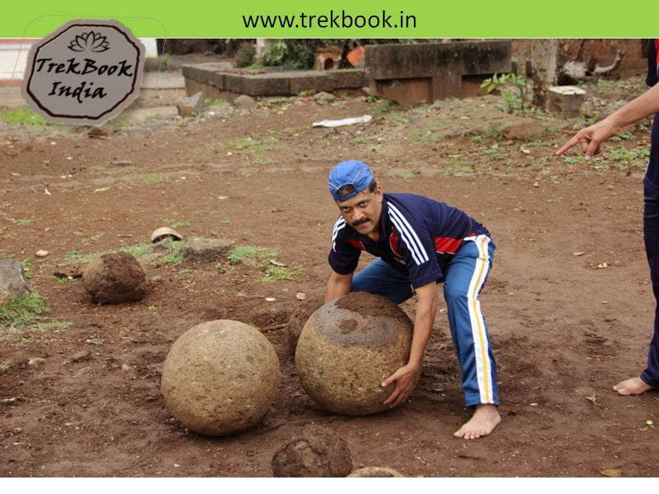 lifting spherical stones at jarandeshwar